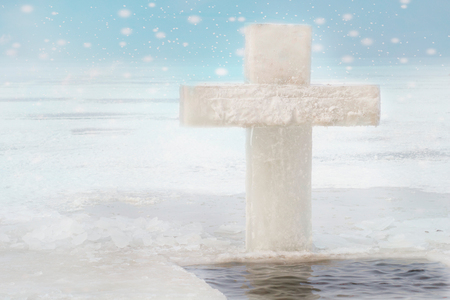Ice cross hole and a cross of ice for the holidays of Orthodox baptism in Russia