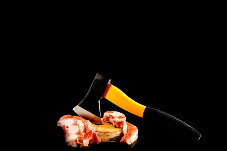 Raw Fresh Marbled Meat Beef ax on a black background. space for Text. Standard-Bild