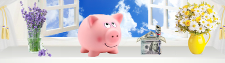 A pink piggy bank with new home house imagination vision with blue sky