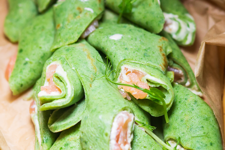 green spinach pancakes with fish on catering.