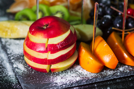 Assorted fresh ripe fruits. Healthy Food concept background. Apple focus. Фото со стока