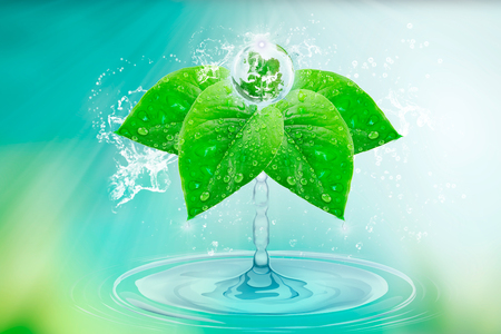 Water is life. Splashes of pure water Give birth to a planet on green leaves with drops and splashes. Wallpaper to the day of the earth.