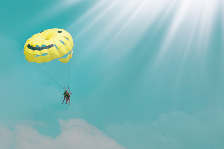 A colorful parachute on a blue sky background. Beautiful summer background. Active holiday on vacation. Healthy lifestyle. Stock Photo