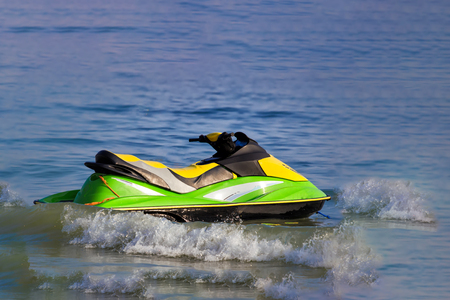 Tourists enjoy driving jetski on the ocean