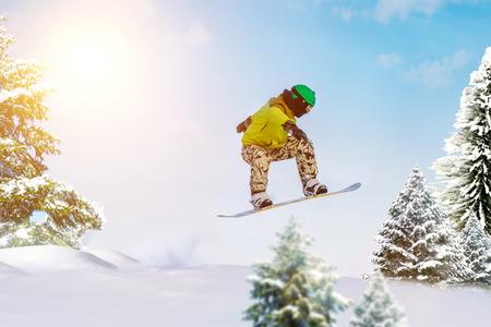 Snowboarder jumps in forest. Freeride snowboarding in Sheregesh ski resort Фото со стока