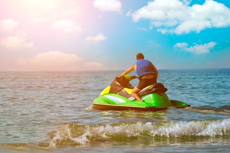 Tourists enjoy driving jetski on the ocean
