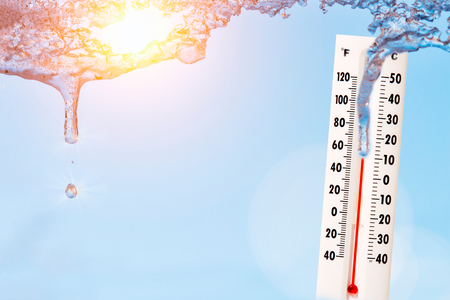 Thermometer with sunny sky.High temperature concept.