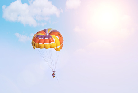 Air parachute in the sky. Water parachute on three places. Parasailing. Standard-Bild