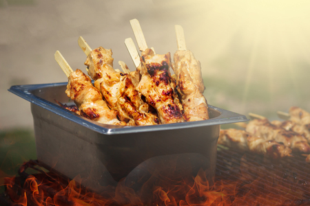 Traditional yakitori chicken stand in Japan at street food vendor market, grilled satay. Japanese good Food.