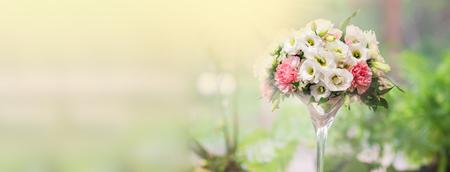 Beautiful bouquet of flowers in vase on window background Фото со стока