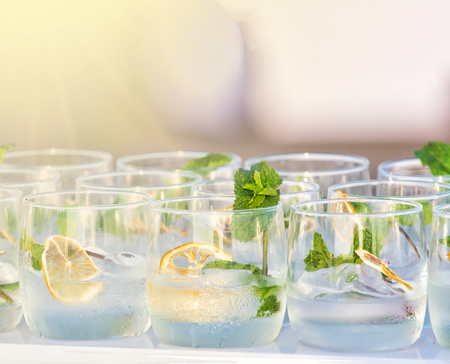 Limes, refreshing drink - sparkling water with ice and limes, lemonade Фото со стока