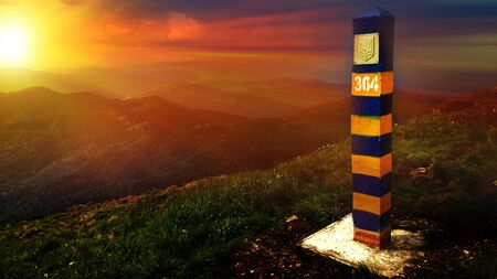 Ukrainian border pillar with coat of arms closeup. Mountains Romania