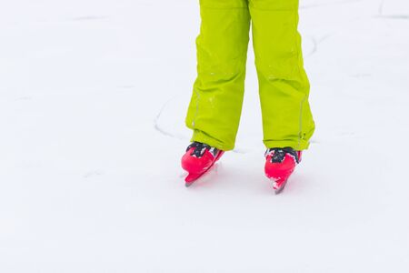 Red ice skates on frozen lake