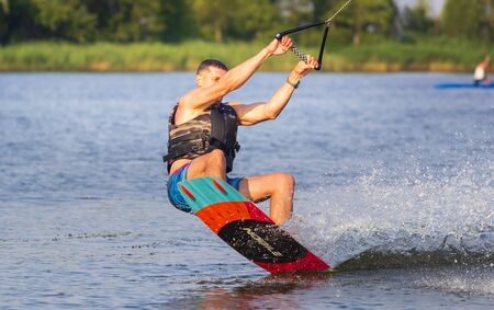 Cherkassy, Ukraine - July 19, 2019: Wakeboarder showing of tricks and skills at wakeboarding reverse event in Cherkassy