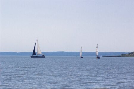 Sailing ship yachts with white sails in a row Stok Fotoğraf