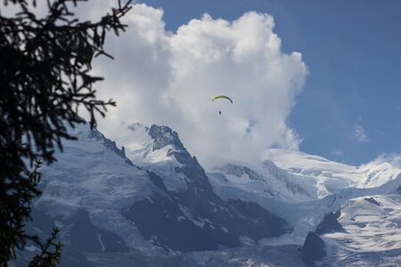 Paragliding over Mont Blanc massif in the French Alps above Chamonix.