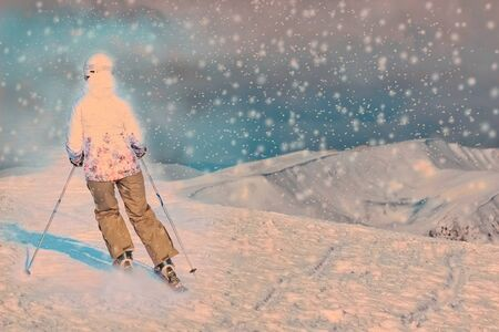 Skier in high mountains. Winter sport