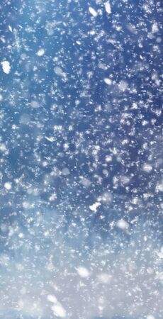 Abstract winter christmas background with shiny snow and blizzard. Soft focus. Space for text. Vertical for stories Banco de Imagens