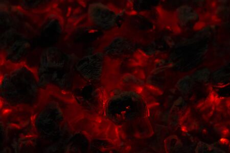background from a fire, conflagrant firewoods and coals. red