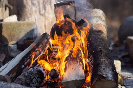 Old vintage Kettle put on a fireplace. Camfire tea
