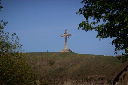 big iron cross against the sky. Religion