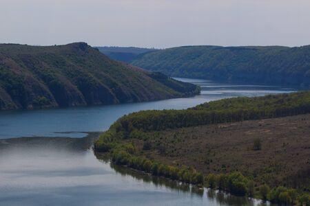Zigzag river flows between summer valleys.Dniester river. Podolsk Tovtry Reserve