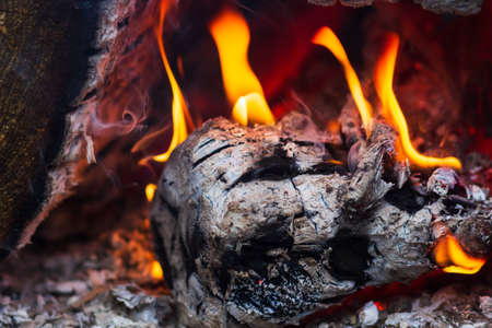 Burning hot to the red wood oven with flame of fire .