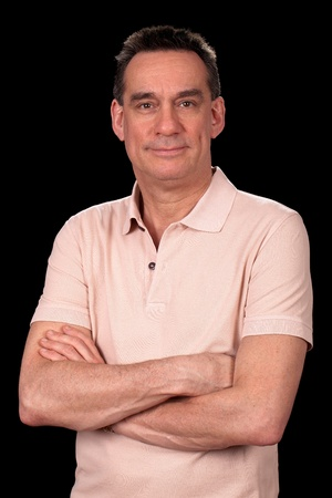 Portrait of Attractive Smiling Middle Age Man in Casual Clothes