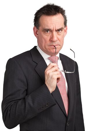 Frowning Angry Businessman Holding Glasses photo