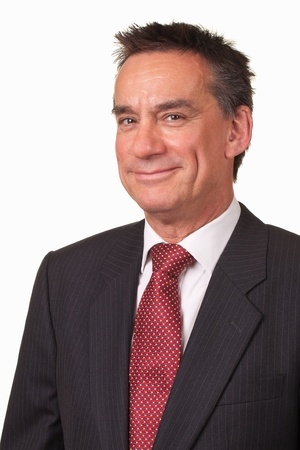 Portrait of Attractive Middle Age Business Man in Suit with Cheeky Smile