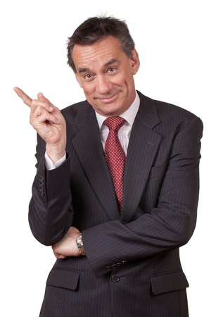 Attractive Smiling Middle Age Business Man in Suit Pointing Left