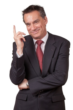upwards: Attractive Smiling Middle Age Business Man in Suit Pointing Upwards Stock Photo