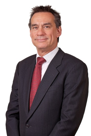 Portrait of Attractive Smiling Middle Age Business Man Stock Photo