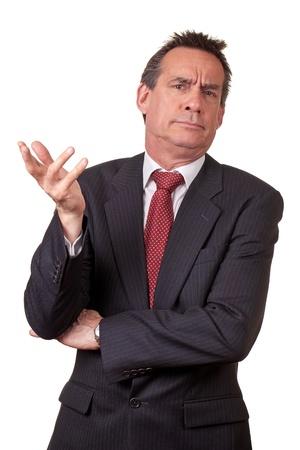 decepcionado: Hombre de negocios de mediana edad molesta en traje