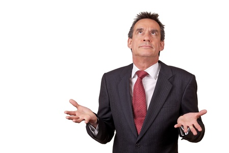 exasperated: Attractive Exasperated Middle Age Business Man in Suit Raising Eyes