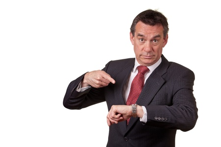 Annoyed Business Man Pointing at Time on Watch
