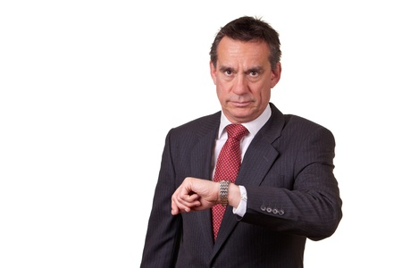 Frowning Angry Business Man Looking at Time on Watch photo
