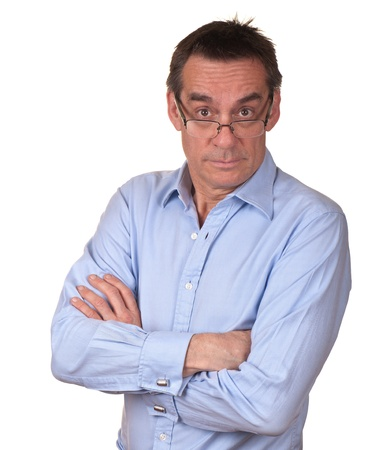 Suprised irritated Middle Age Man in Blue Shirt with Glasses photo