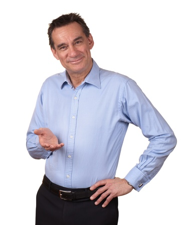 Smiling Middle Age Man in Blue Shirt Holding one hand forward  Stock Photo