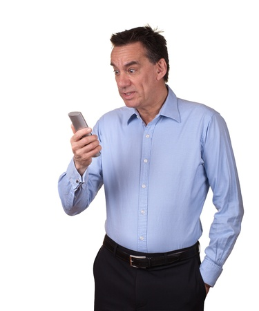 Attractive Middle Age Man in Blue Shirt Looking at Phone with Startled Expression