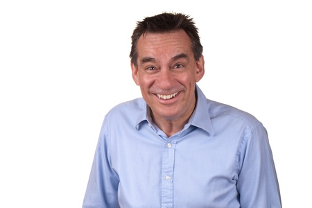 Attractive Middle Age Man in Blue Shirt Laughing with Silly Smile photo