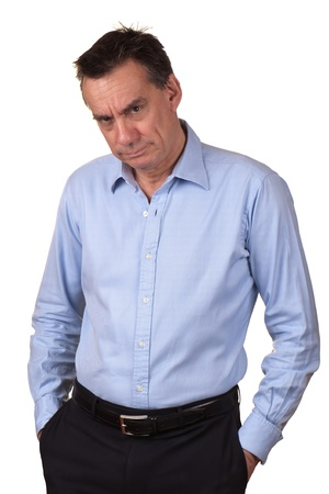 Angry Middle Age Man in Blue Shirt with Grumpy Expression and Hands in Pockets photo
