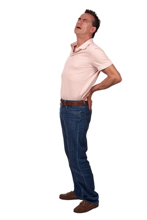 suffering: Full Length Portrait of Middle Age Man with Back Pain wearing Casual Clothes Stock Photo