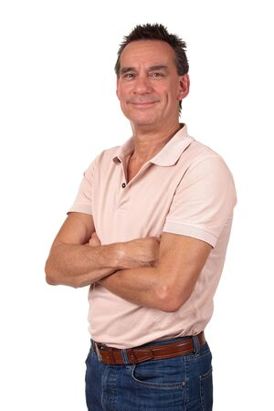 Portrait of Attractive Smiling Middle Age Man in Pink Polo Shirt and Blue Jeans