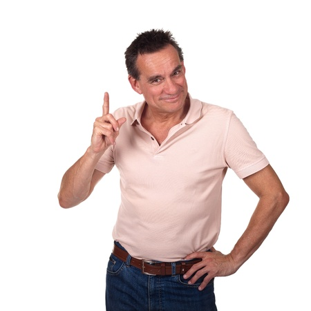 Attractive Smiling Middle Age Man Pointing Upwards or Wagging Finger with Cheeky Grin and Hand on Hip Stock Photo