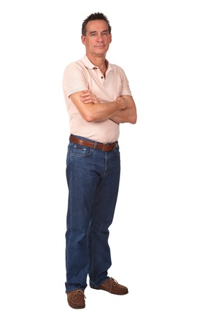Full Length Portrait of Attractive Middle Age Man Smiling with Arms Folded