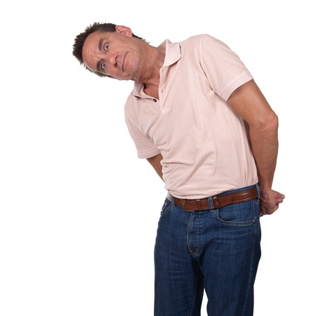 bent over: Attractive Middle Age Man Looking Sideways at Something and Surprised or Scared with Hands Behind His Back