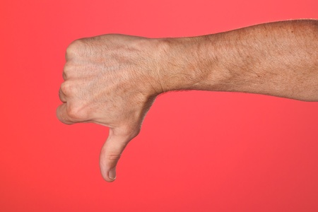 Thumbs Down Sign on Red Background with Copy Space photo