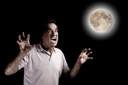 Scary Man Werewolf Fango Beast under Full Moon at Halloween photo