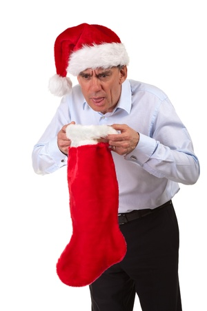 Business Man in Santa Hat Throwing Up into Christmas Stocking photo